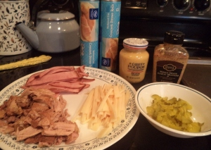 The ingredients: pork, swiss cheese, ham, crescent rolls and mustard.